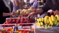 People shopping at at street market in Italy video