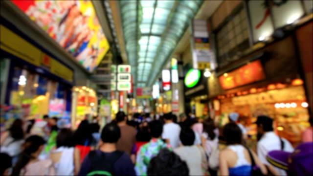 People shopping at osaka japan. defocused background. video