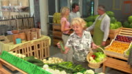 HD DOLLY: People Shopping In Greengrocer'S Shop video