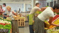 HD DOLLY: People Shopping In Produce Store video