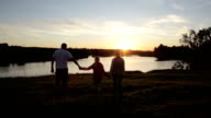 People silhouettes on summer sunset video