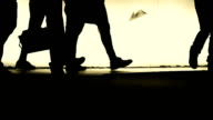 People silhouettes walking slowly by night video