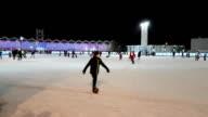 People skate on the skating rink in the park Sokolniki video