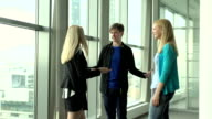People stand near the window and talking. video