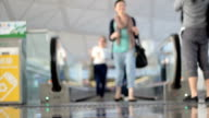 People Stepping Off Mover At Airport video