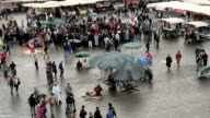 People strolling around the booths and stalls in Jemma Dar Fna,  Marrakech, Morocco video