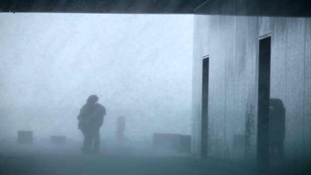 people struggling inside hurricane force extreme weather rain storm blizzard video