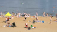 People sunbathing on the crowded sand beach video