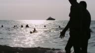 People swimming in the ocean video