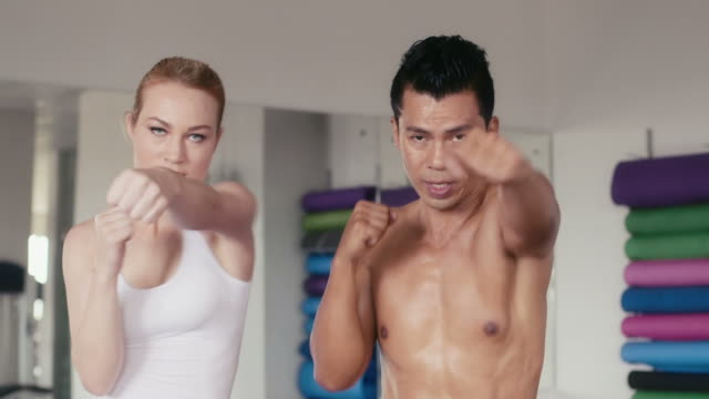 People training, exercising, gym, fitness club, sport, martial arts video