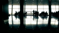 People travelers walking in airport or railway station waiting hall, time-lapse video