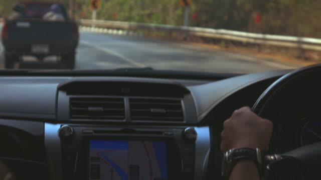 people traveling road trip with GPS technology in car video