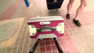 People traveling with luggage video