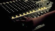 People using mixer controller for mixing music, Low key video