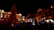 People visit Christmas Fair in old town at evening in Riga, Latvia. Blurred video