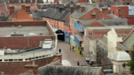 People walk down a quiet Tamworth street - high rooftops video