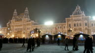 People walk on New Year Fair near GUM shopping center on Red Square. video