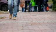 People walk on the sidewalk. Daytime. video