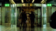 People walk through revolving door at airport video