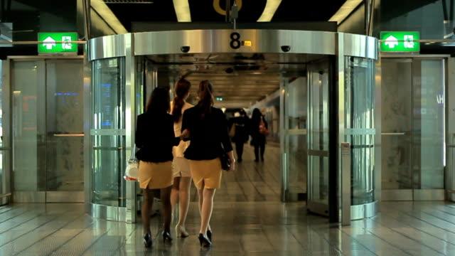 SLOW MOTION People walk through revolving door at airport video