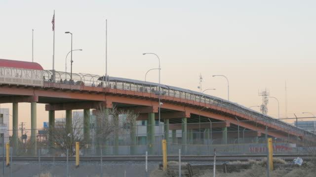 People Walking Across the Border on a Bridge video