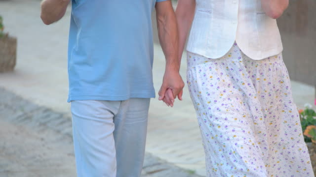 People walking and holding hands. video