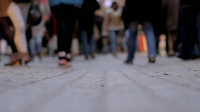 People walking around camera - surface level view video
