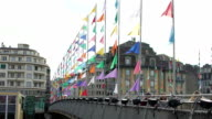 People walking bridge decorated with many colorful banners, festive atmosphere video