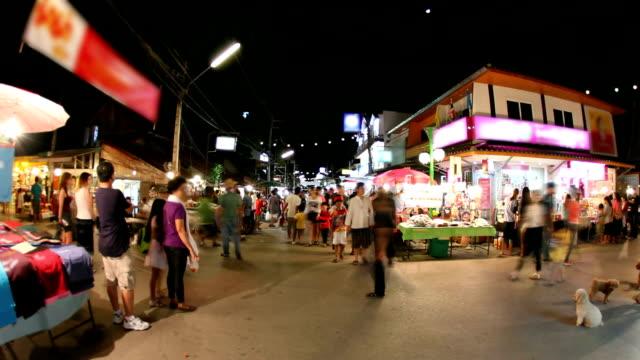 People walking in night market video