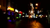 People walking in old town of Riga, Latvia at evening. Blurred video