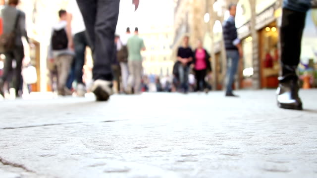 People walking in street - Surface level shot video