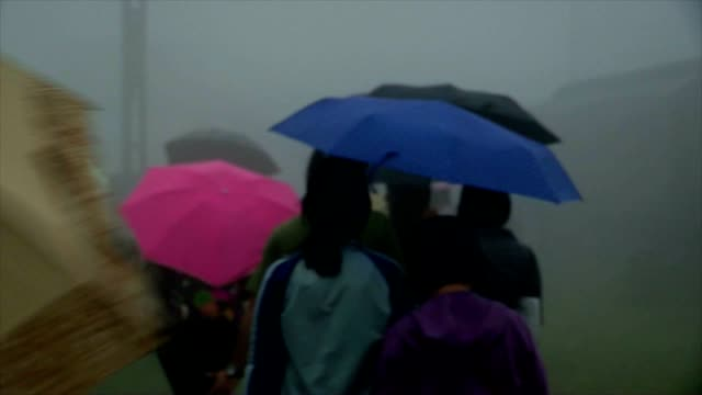 People walking in the mist during rainy day video