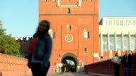 People walking near Troinskaya tower of Moscow kremlin timelapse, Russia video