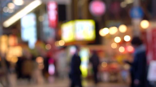 People walking night light background busy big city, Osaka, Japan video