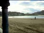 People walking on beach in San Sebastian Spain video