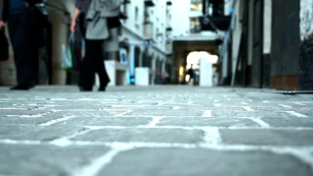 People walking on cobblestones  (soft focus) video