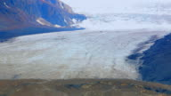 People Walking on Glacier Icefield, Extreme Zoom Shot video