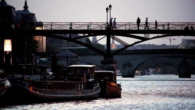 People walking on one of the many bridges in Paris video