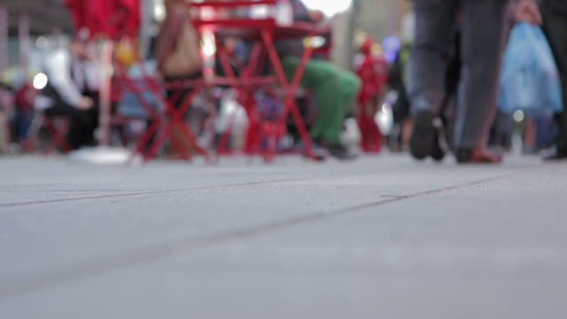 People walking on sidewalk in Time Square New York City video