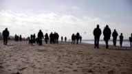 People walking on the beach video
