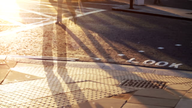 People walking, pedestrian crossing, seamless loop. HD, NTSC, PAL video