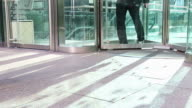 HD: People Walking Through Glass Door video