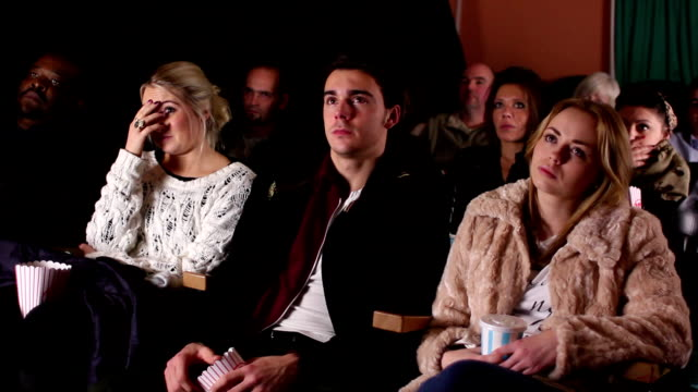 People watching horror / thriller movie at cinema / theatre video