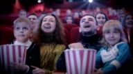 people watching movie at cinema and laughing video