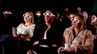 People watching Movie at the cinema in 3D glasses video