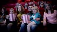 people watching movie in cinema video