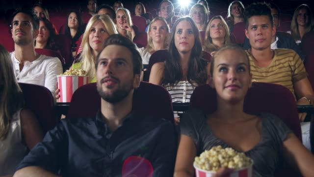 People watching movie video