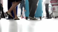 People with baggages walking at airport video