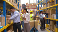 People working at a distribution warehouse video