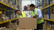 People working at a warehouse video